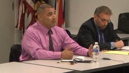Former Sandusky County Sheriff's Deputy Jose Calvillo, left, with union attorney Joe Hegedus, is seen in this screen capture of an April 24 video answering questions about computer misuse.