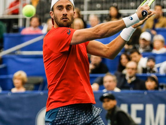 Steve Johnson returns the ball against Taylor Fritz during the fourth day of the Memphis Open at the Racquet Club in East Memphis on Feb. 11, 2016.