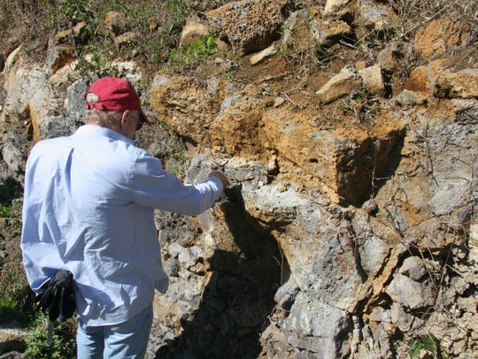 Prof. Lewis D. Ashwal studyies an outcropping of trachyte