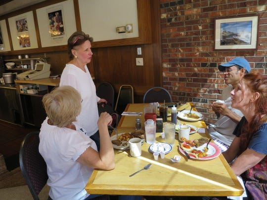 Kathe Jewett, 68, a waitress at the Howard Johnson restaurant in Bangor, Maine, since it opened in 1966, speaks to patrons Tuesday. The restaurant, one of the last two HoJos, will close Sept. 6.