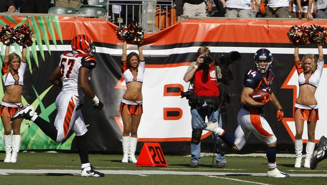 The Cincinnati Bengals Dhani Jones can't catch up to the Denver Broncos Brandon Stokley after a game winning reception on tipped ball in the final seconds of the game at Paul Brown Stadium.