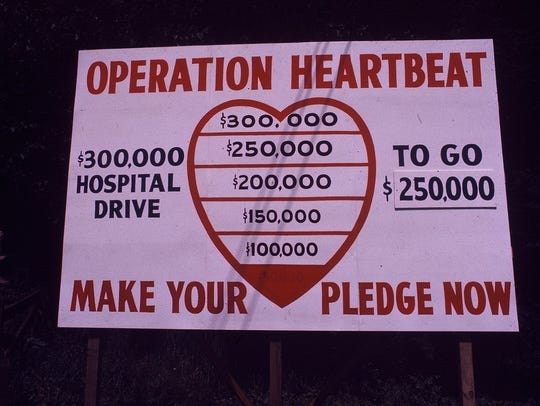 Community fundraising, as shown in this decades-old photograph, and government help made Angel Medical Center in Franklin a nonprofit and paid for its expansion. Some residents of rural areas worry they won't have enough say in the future of hospitals like Angel if they are sold to HCA Healthcare.