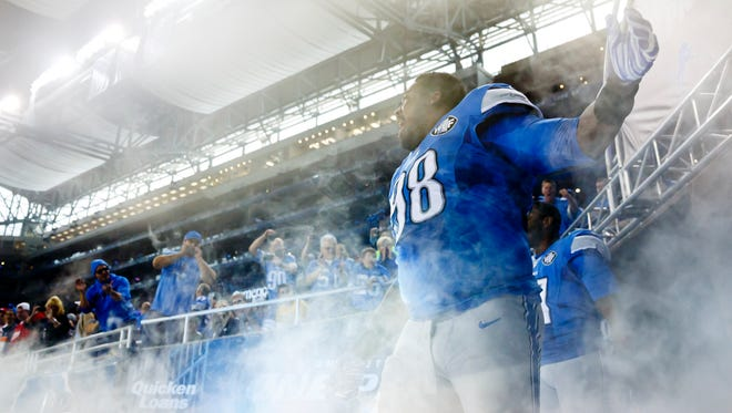 Detroit Lions defensive tackle Nick Fairley gets introduced before a game against the Green Bay Packers on Sept. 21, 2014.