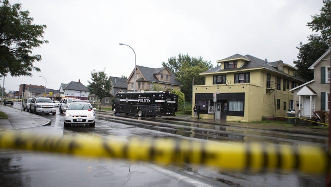 Police investigate the scene of a police-involved shooting on Lyell Avenue on July 9, 2015.