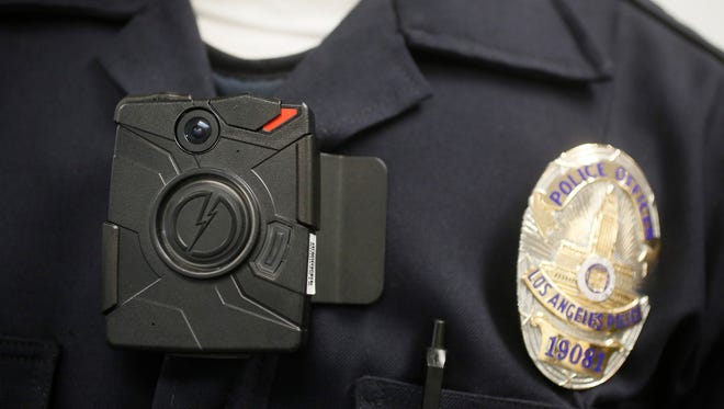 A Los Angeles police officer wears a body camera during a demonstration.