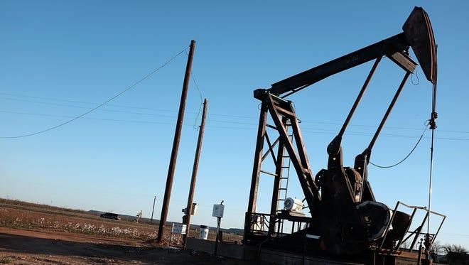 An oil pumpjack works  in Sweetwater, Texas.
