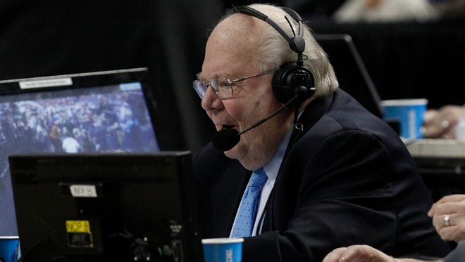 Verne Lundquist works in the second half of a men's college basketball game between Saint Joseph's and Connecticut during the second round of the 2014 NCAA tournament.