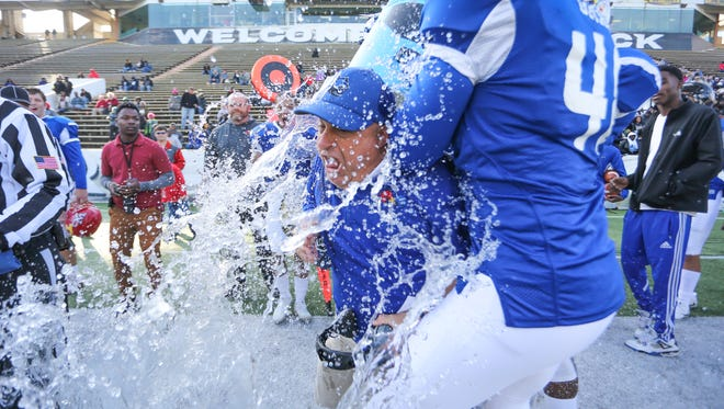 Mississippi head football coach Lance Mancuso is doused with water as the clock ticks down in the annual MS-AL All-Star Football Game Saturday at the University of Southern Mississippi.