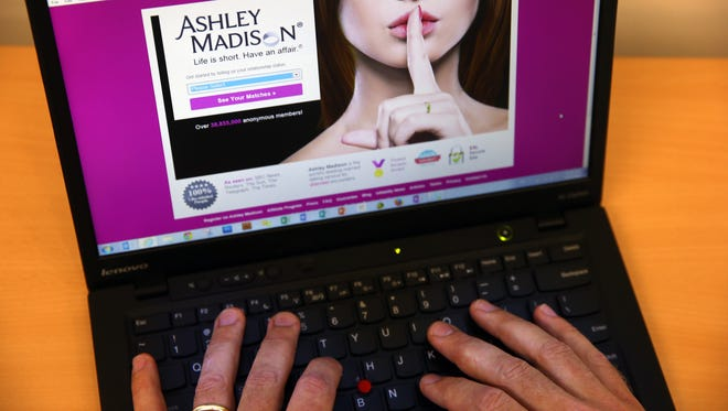 In this photo illustration, a man visits the Ashley Madison website. Ashley Madison is a hookup sight for husbands and wives who want an affair.