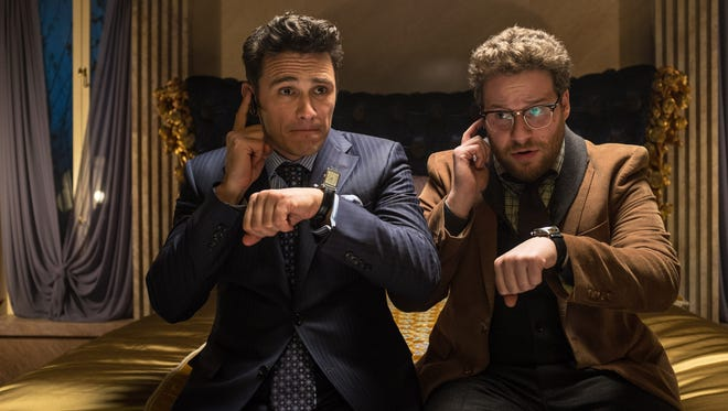 """This photo released by Sony - Columbia Pictures shows James Franco, left, as Dave and Seth Rogen as Aaron in a scene from Columbia Pictures' """"The Interview."""""""
