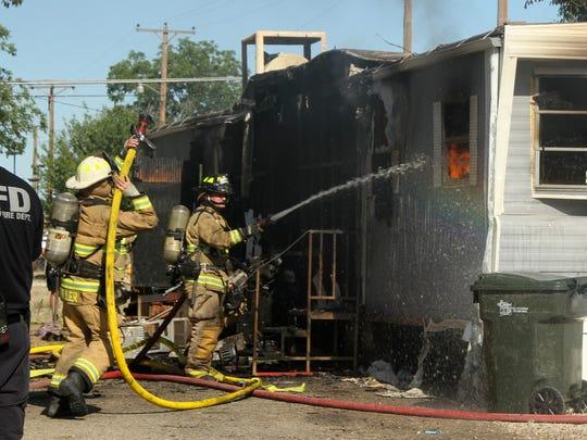 Crews were still working to extinguish hot spots around 5 p.m. on Wednesday.