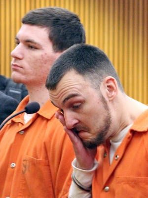 Oscar Ernest Lance wipes his face during a  2015 bond hearing. Lance and his younger brother, Jacob Lance (left),  were sentenced to prison Wednesday in the death of Todd Cantlay.