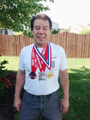 FILE -- Ray Fougnier of Pigeon Forge set four world