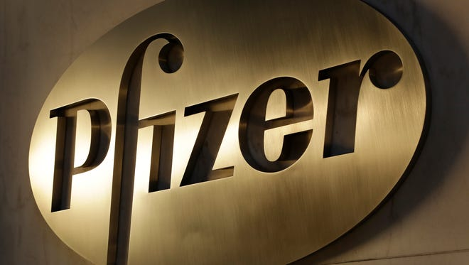 In this Monday, Nov. 23, 2015, file photo, the Pfizer logo is displayed at world headquarters in New York. After a tax ruling against Apple on Tuesday, Aug. 30, 2016, the spotlight turns to dozens of companies that have boosted earnings taking advantage of low tax rates abroad. Drugmaker Pfizer benefited the most from paying low foreign taxes in 2015, according to an R.G. Associates study.