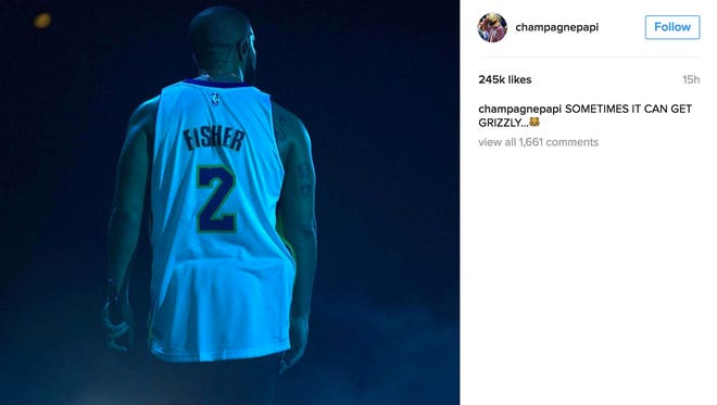 """Drake shared a photo of himself in a Derek Fisher jersey at his concert with the caption, """"Sometimes it can get grizzly."""""""