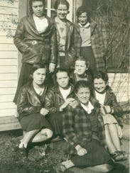 Elizabeth Reeves Lang, back row center, at camp in