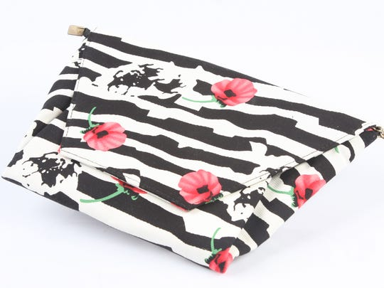This black and white modern zebra stripe clutch has pink flowers and plenty of panache. $49 at Work the Metal, 1201 Story Ave.