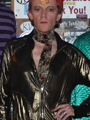 Mark Casson, lead singer of Asheville's Wham Bam Bowie Band, recreates David Bowie's look from the Ziggy Stardust era.