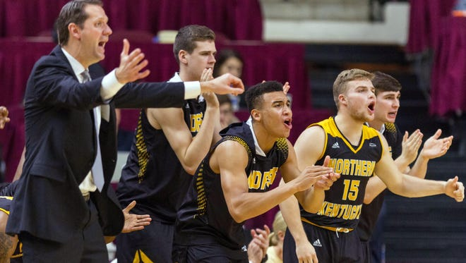 Northern Kentucky Norse head coach John Brannen and center Chris Vogt (33) and guard Paul Djoko (2) and guard Tyler Sharpe (15) celebrate a three-pointer against the Texas A&M Aggies in the second half at Reed Arena.