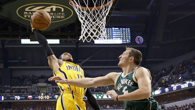 Indiana Pacers guard Monta Ellis (11) goes high in the air for a dunk over Milwaukee Bucks forward Mirza Teletovic (35) in the second half of their game Saturday, February 11, 2017, evening at Bankers Life Fieldhouse. The Indiana Pacers lost to the Milwaukee Bucks 116-100.