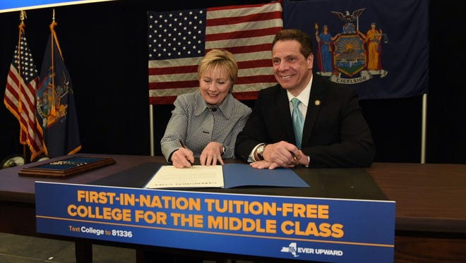 Hillary Clinton joined New York Gov. Andrew Cuomo on April 12, 2017, in Queens, N.Y., for a ceremonial bill signing that will allow New Yorkers whose families make below a certain income to have free tuition to State University and City University of New York programs.