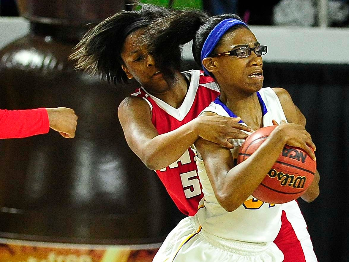 East's Kyra Trice (5) wraps up Westview's Titi Vincent (31) as East Nashville wins over Westview High School 35-32 in the Division I Class AA Girl's basketball semi-finals at the Murphy Center on MTSU's campus March 11, 2016 in Murfreesboro, Tenn.
