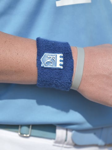 A detail view of the wristbands worn by all members