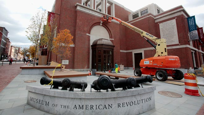 """In this Monday, Oct. 24, 2016 photo, construction continues on the exterior at the Museum of the American Revolution in Philadelphia. History buffs will be able to peer into the eyes of a """"most excellent likeness"""" of George Washington and get an actual whiff of the Revolutionary War when Philadelphia's Museum of the American Revolution opens next year. The collection of art, printed works, immersive exhibits and objects from the Revolutionary Era opens April 19."""