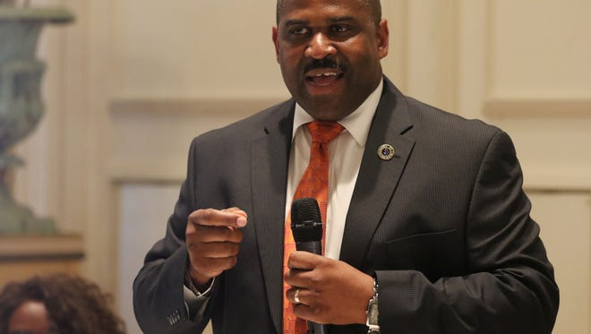 Monroe Police Chief Quentin Holmes talks about crime prevention during a Garden District Neighborhood Alliance meeting at Grace Episcopal Church in Monroe on Tuesday, June 7, 2016.