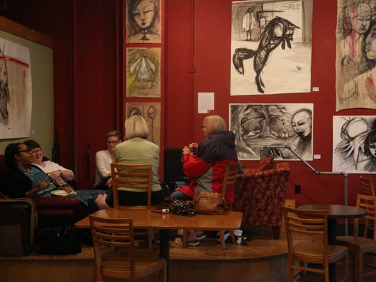 A group of women have a conversation at Ritual Cafe