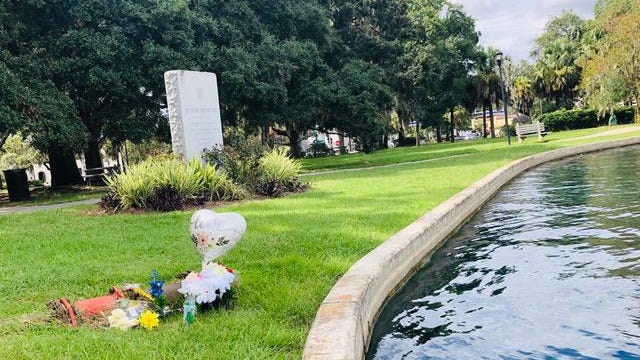 A homemade memorial marks the spot along the edge of the Daffin Park lake where a 3-year-old boy recently drowned.