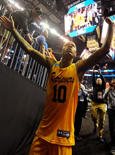 2018: UMBC's Jairus Lyles celebrates his team's 74-54 win over Virginia. Maryland-Baltimore County became the first No. 16 seed to defeat a No. 1 seed in the history of the NCAA tournament.