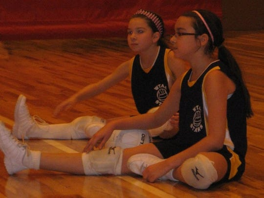 Sarah and Annabelle Dunn are pictured warming up prior