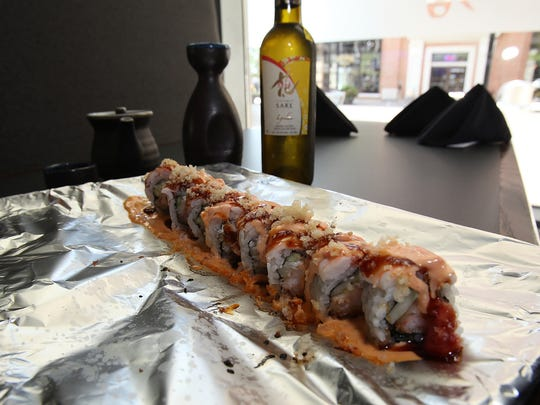 Kaji roll and sake at Akebono 515 in downtown Des Moines. The restaurant offers sushi and creative Japanese and fusion dishes.