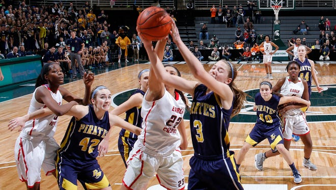Pewamo-Westphalia's Hannah Spitzley (3) and Detroit Edison's Shaulana Wagner fight for a rebound during their MHSAA Class C championship game, Saturday, March 18, 2017, in East Lansing, Mich. P-W fell 46-44.