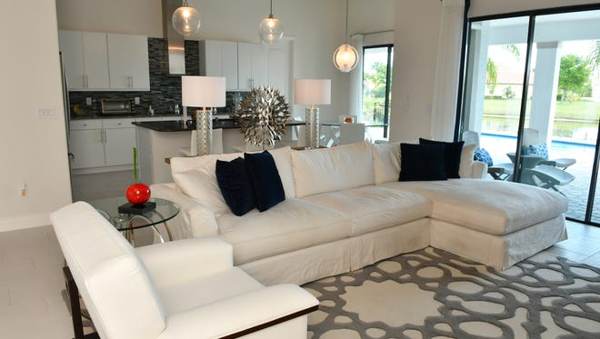 A contemporary and organic look. Saidee Carmichael, senior designer with Michael Gainey Signature Designs decorated much of this home of Juan and Beatriz Perez in Fairway Lakes in Viera.