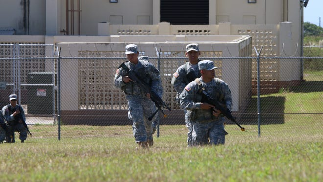 Soldiers from the Guam Army National Guard's 1st-294th Infantry Regiment conduct squad situational exercises during unit training activities.