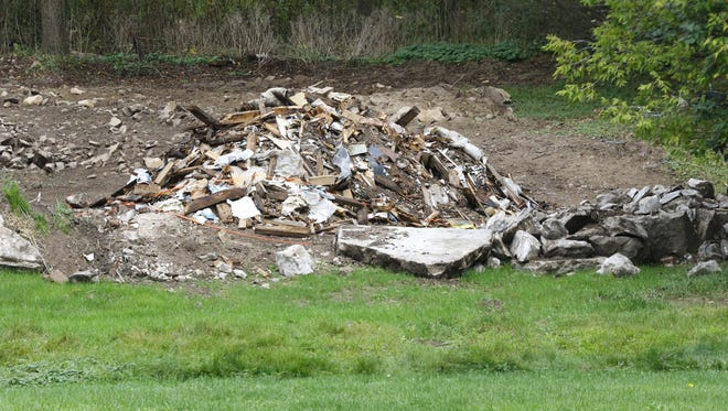 A pile of rubble and debris left from a property demolished on Kickbusch Street Tuesday, September 26, 2017, in Wausau, Wisc.