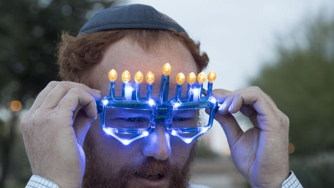 Rabbi Levi Levertov - Chabad of downtown Phoenix lighting the first candle as Hannukah begins at sundown in front of Wesley Bolin Plaza in Phoenix, Dec 12, 2017.