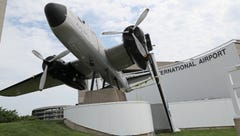 Broken wing of Mitchell bomber monument at Milwaukee airport in need of repair