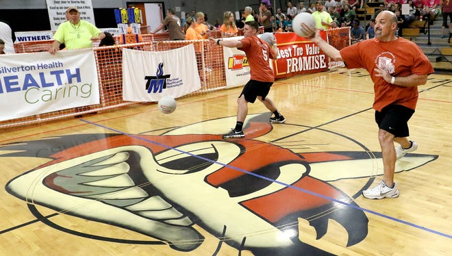 John Horner, of Silverton, right, throws the ball at center court while competing in the Dodge, Duck, Dip, Dive & Donate Dodge Ball Tournament in 2015.