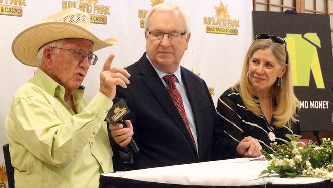Racehorse owner Tom McKenna, left, announces that his prized thoroughbred, Conquest Mo Money, will not run in the Kentucky Derby but in the Preakness instead during a press conference Tuesday at Sunland Park Racetrack and Casino. At far right is his wife, Sandy McKenna and at center is Tom Dawson of Sunland Park Racetrack and Casino.