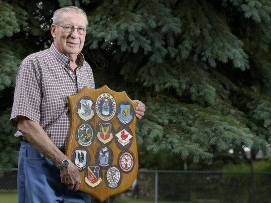 Bill Remter holds a plaque displaying the units he served with during his time in the U.S. Air Force from 1953 to 1973. Remter, of Appleton, will be part of the Old Glory Honor Flight to Washington, D.C., on Thursday.
