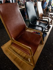 Chairs created by Wood Studios are displayed at the