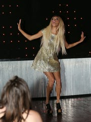 """""""Enjouli Tatiana"""" performs in a drag show at Martha's"""