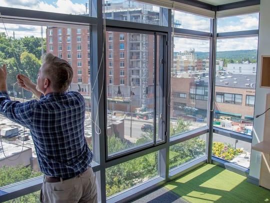 Local developer Frost Travis opens the curtains of