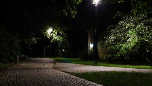 Stock image of a city park at night.