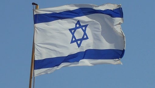 Low Angle View Of Israeli Flag Against Clear Blue Sky