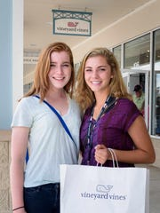 Pittsburgh residents Meredith Brown (left) and Lindsey Miller, both 17, stand outside the Vineyard Vines location at Tanger Outlet Mall in Rehoboth Beach on Tuesday. They said they saw shirts at the Rehoboth Lifestyle Clothing store and knew right away they were imitations.