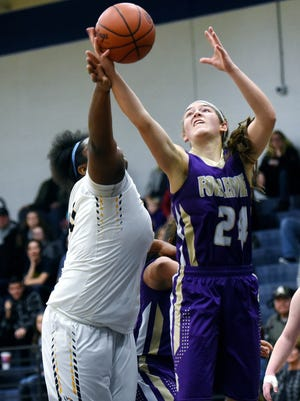 Fowlerville's Elie Smith, right, grabs a rebound over Haslett's Imania Baker during the second quarter on Tuesday, Dec. 19 2017, at Haslett High School. Haslett won 51-49.